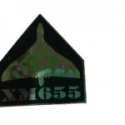 XM655 Pin Badge
