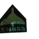 XM655 Pin Badge