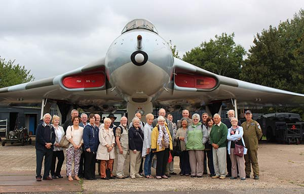 The 19 Signals Regt. Association visitors with Derek Powell, curator of the Wellesbourne Wartime Museum on the left, and Charles on the right